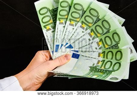 Euro Currency, European Uninon Money, Hand Holding Euros Cash On The Black Background