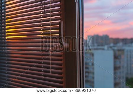 Morning The Sun Shining Through Jalousie, Curtain With Building Background.