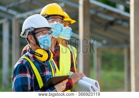Engineer Wearing Protective Mask To Protect Against Covid-19  Working On Checking And Maintenance In