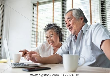 Relaxing Asian Senior Couple Making Video Call And Talking With Family On Laptop Computer. Happy Smi