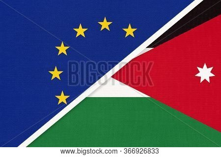 European Union Or Eu And Hashemite Kingdom Of Jordan National Flag From Textile. Symbol Of The Counc