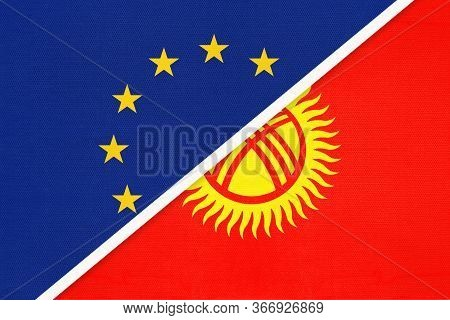 European Union Or Eu And Kyrgyzstan National Flag From Textile. Symbol Of The Council Of Europe Asso