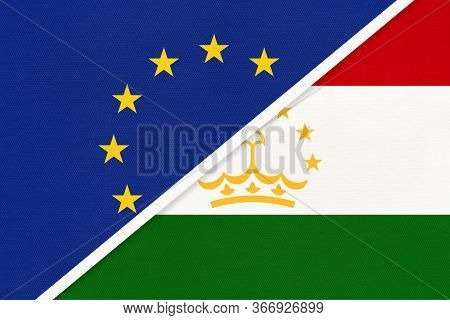 European Union Or Eu And Republic Of Tajikistan National Flag From Textile. Symbol Of The Council Of