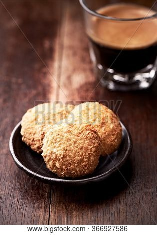 Butter Cookies And Coffee In Glass Cup On Rustic Wooden Background. Close Up.