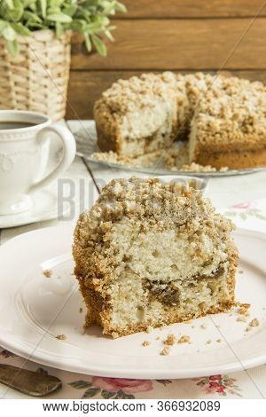 Homemade Cinnamon Streusel Coffee Cake On Rustic White Wooden Table.