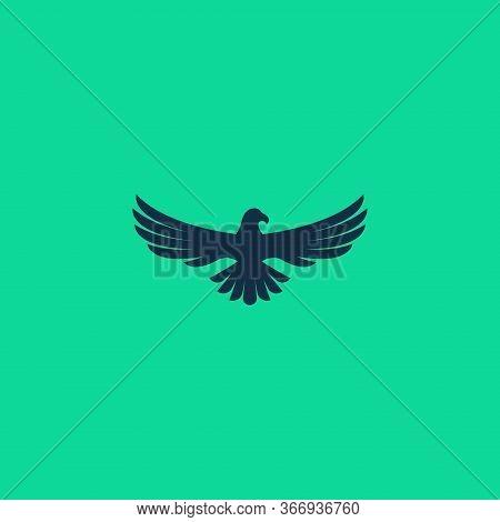 abstract simple eagle logo design isolated on green background color. Eagle icon, Eagle Design Vector, Luxury Eagle, Eagle Icon Picture, Eagle Icon Vector, Eagle Falcon, Eagle Logo white shield, Head Eagle logo Design, Eagle Falcon Vector Logo Template, E