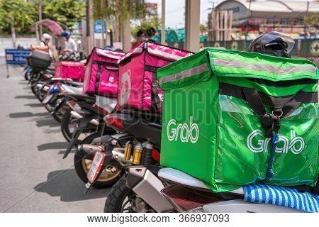 Bangkok, Thailand - April 2020 : Grab Food Logo On Food Box On The Motorcycles Between Food Panda At