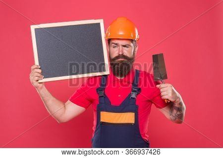 Renovation Company Services. Professional Plasterer. Skillful Plasterer. Bearded Man Worker With Pla