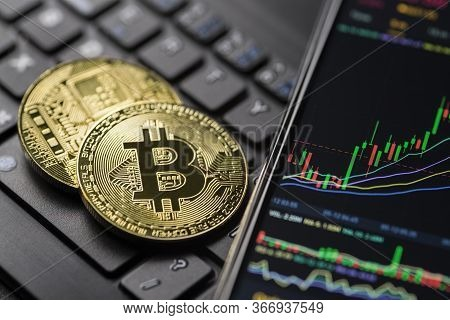 Bitcoin Gold Cryptocurrency Trading Chart On Smartphone Close Up.