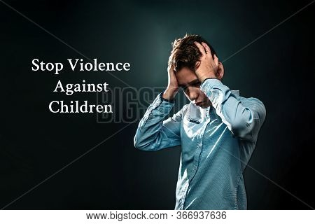 The Concept Of Domestic Violence. A Teenage Boy Holds His Hands Over His Head, Experiencing Stress.