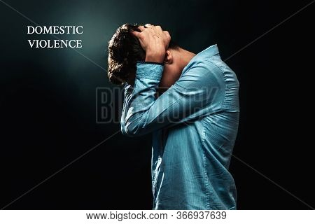 The Concept Of Domestic Violence. A Teenage Boy Covers The Back Of His Head With His Scratched Hands