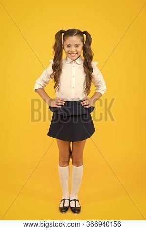 Fashion Trends For Back To School. Happy Schoolchild With Fashion Look On Yellow Background. Small G