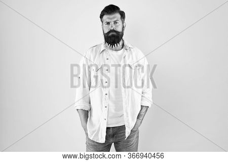 Man Clothespin On Beard. Brutal Male Put Clothespin With Hearts On Beard. Bearded Man Hipster Casual