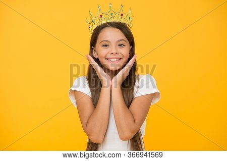 Compelling Baby. Kid Wear Golden Crown Symbol Of Princess. Girl Cute Baby Wear Crown Yellow Backgrou