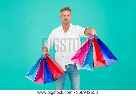Shop And Enjoy. Happy Shopper Blue Background. Handsome Man Hold Shopping Bags. Gift Shop. Holiday P