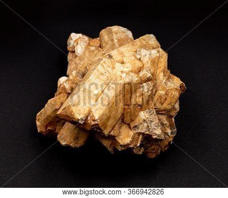 Cluster Of Feldspar Mineral Crystals Isolated Dark Background. Geology Mineralogy Magazines Websites
