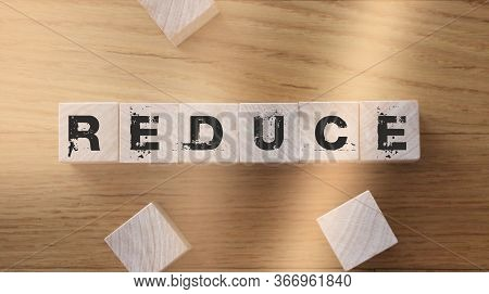Reduce Word Written On Wood Block. Reduce, Reuse And Recycle Ecological Usage Comsumption Minimizati