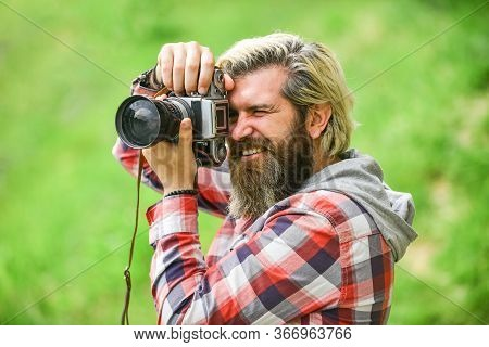Enjoying Hot Day. Bearded Man Hipster Take Photo. Photo Shooting Outdoor. Brutal Man Traveler With R