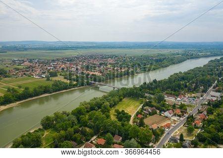 Establishing Aerial View Of Tahi And Tahitotfalu Separated By The Danube River. Zoltan Tildy Bridge.
