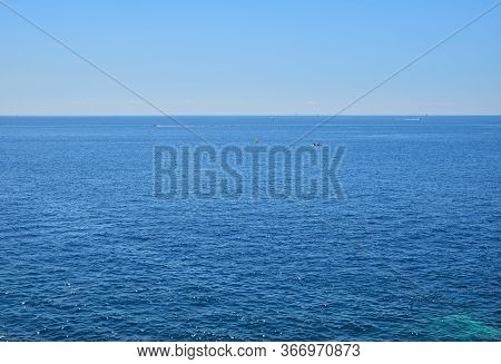 Tranquil Seascape With Calm Sea Water Ripples And Waves Under Clear Day Blue Sky, High Angle View