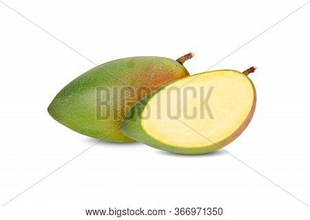 Whole And Sliced Raw Mango With Stem On White Background