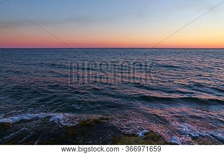 Tranquil Sunset Seascape Scene With Pastel Pink Sky And Calm Sea, High Angle View