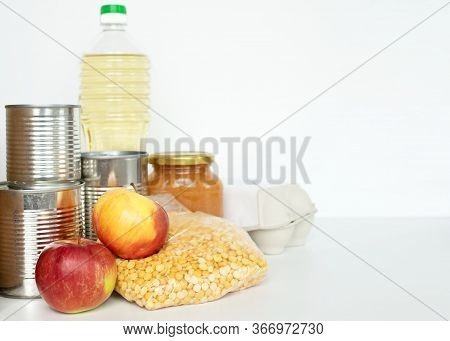 Coronavirus Donation Concept. Donation Box With Food Isolated On White. Canned Food, Dried Peas, Ric