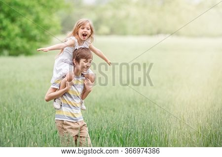 Two Children A Boy And A Girl Together In The Open Air Outside The City, Tenderness Towards Each Oth