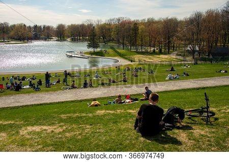 Montreal, Ca - 18 May 2020: People Gathering Near Beaver Lake During Coronavirus Pandemic