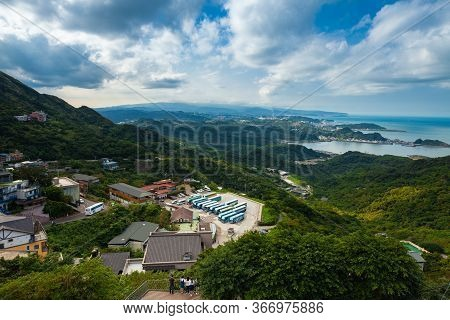 Jiufen, Taiwan - November 07, 2018: Tourists Watch Panoramic View Over The Coastline Of Taiwan From