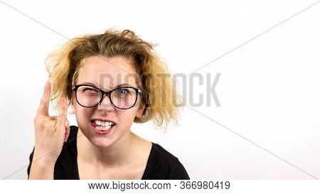A Girl Rocker With Yellow Hair And Glasses Squinting One Eye Shows A Hand Gesture Heavy Metal Hm On