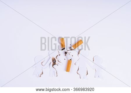 Paper Cut Of Family Members Destroyed By Cigarette On White Background. Smoking Destroying Family Co