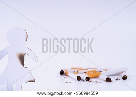 Paper Cut Of Woman Destroyed By Cigarette. Smoking Destroying Life Concept. Quit Smoking For Life On