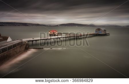 High Tide At Mumbles Pier In Swansea, South Wales Uk, Showing Mumbles Pier And Lifeboat Station.