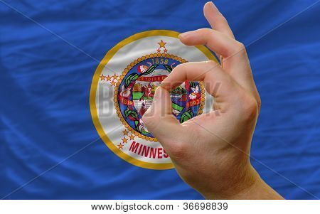 Ok Gesture In Front Of Minnesota Us State Flag