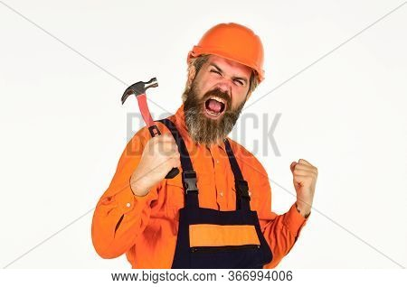Technical Work. Impulse For Changes. Bearded Mature Man In Uniform. Guy With Hammer. Good Hammer. Es