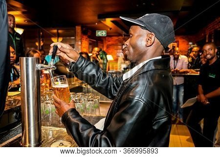 Johannesburg, South Africa - May 15, 2012: African Barman Pouring A Pint Draft Beer At Barman Traini