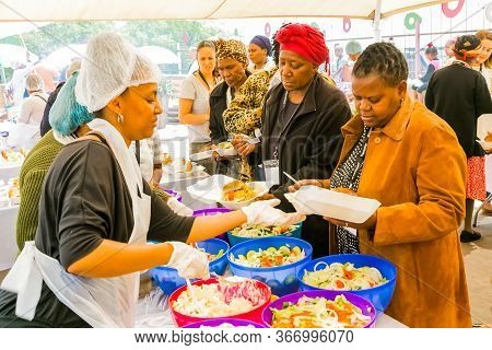 Soup Kitchen Community Outreach Catering Staff Dishing Up Meals For African Children
