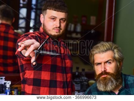 Hipster Client Getting Haircut. Barber With Scissors And Client. Barber Works On Hairstyle For Beard