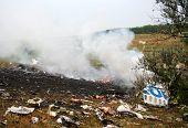 The smoking debris of a plane crash poster