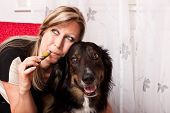 pretty blonde woman with mixed breed dog evaporated E Cigarette poster