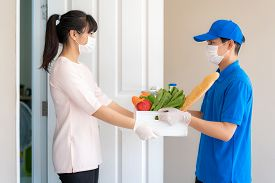Asian Woman Costumer Wearing Face Mask And Glove Receive Groceries Box Of Food, Fruit, Vegetable And