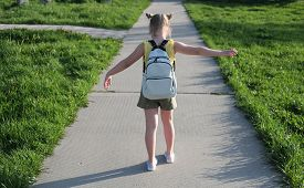 Little Cute Girl Goes To School. Blonde Girl With School Bag And Space Buns Hairdo. Back To School C