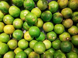 Close Up Green Limes With A Top View To Be Designed Are Background Or Wallpaper