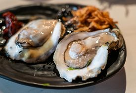 Fresh Oyster Served In Thai Style Seafood With Chili Paste And Fried Onion