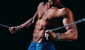 Man With Broken Chains, Holding Chain. Fitness Abdominal Muscle. Muscular Man Exercising Doing Sit U