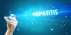 Syringe, medical injection in hand with HEPATITIS inscription, medical antidote concept