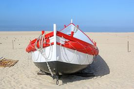 Traditional Fishing Boat On Nazare Beach, Portugal