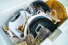 Kitchen Sink With Dirty Dishes And Utensils. Mess And Sink. Dirty Kitchen Utensils