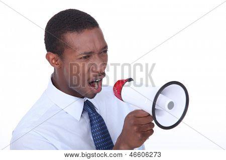 African man shouting through a megaphone